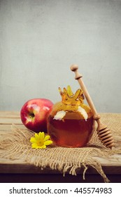 Honey pomegranate jar and apple on wooden vintage table. Jewish holiday Rosh Hashanah vertical background