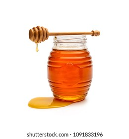 Honey pot and dipper isolated on white background