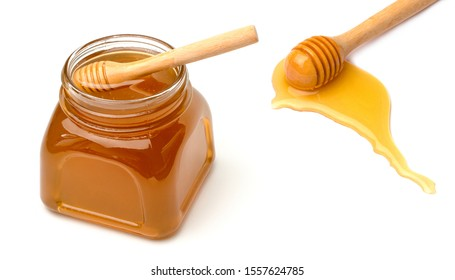 Honey pot and dipper isolated on white background,copy space.