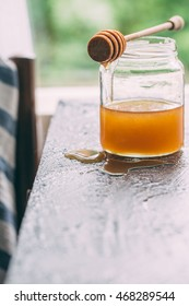 Honey in a pot or jar on kitchen table