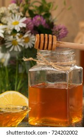 Honey in a pot or jar on a wooden table. Healthy organic food