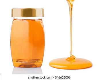 Honey pouring and honey bottle isolated on white background