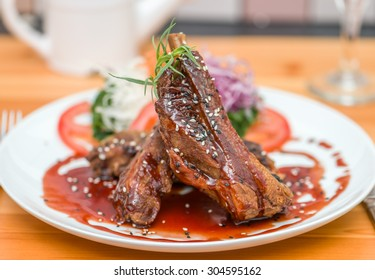 Honey roast ribs with hoi sin sauce and sesame seed