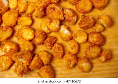 honey roasted macadamia nut on wooden board