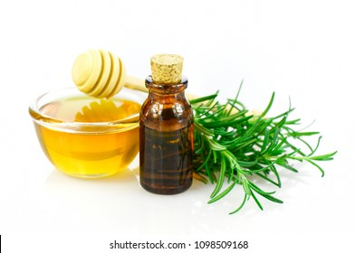 Honey, rosemary and essential oil homeopathy remedy recipe on white background.