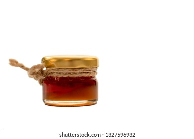 Honey in small jar with jute string decoration, isolated