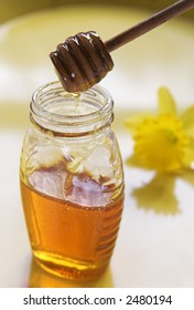 honey with spoon and flower