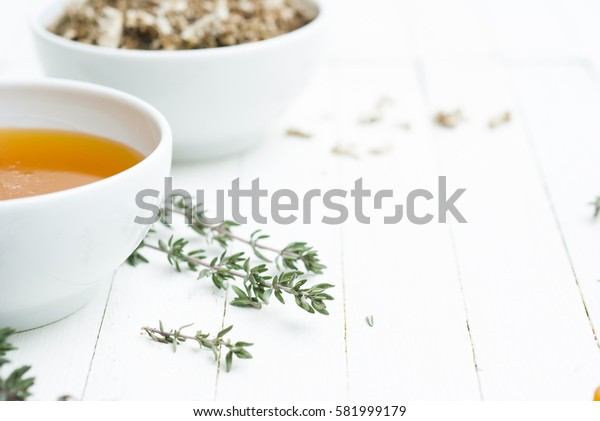 honey, thyme twigs on white wood table background