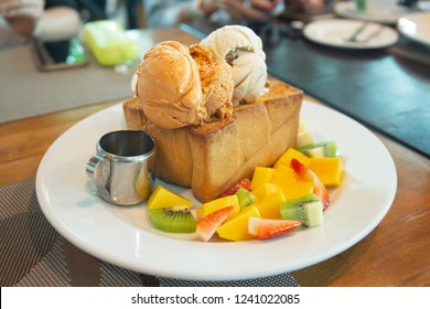 Honey toast with fresh mango,strawberry, kiwi, banana and honey with ice cream recipe