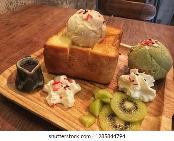 Honey toast with Ice cream and kiwi.