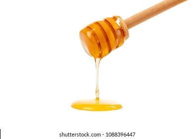 honey with wooden drizzler isolated on white background