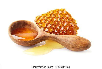 Honey in wooden spoon with honeycomb