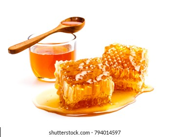Honeycomb with bowl and honey spoon isolated on white background, bee products by organic natural ingredients concept
