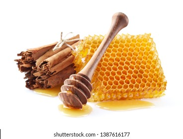 Honeycomb with cinnamon spices in closeup
