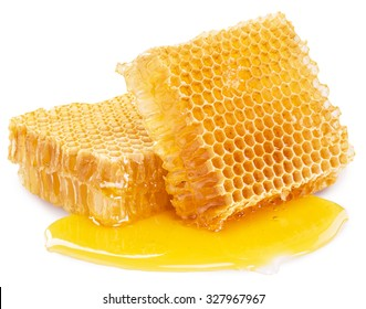 Honeycomb with fluid honey isolated on a white background. File contains clipping paths.