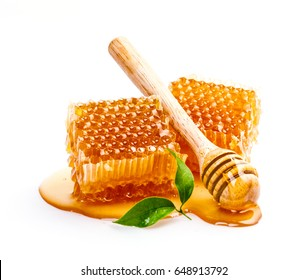 Honeycomb with honey dipper and leaf isolated on white background, bee products by organic natural ingredients concept