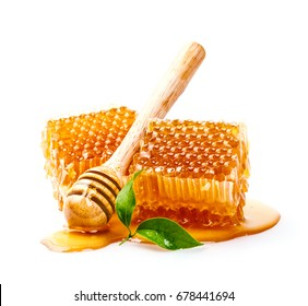 Honeycomb with honey dipper and leaf isolated on white background