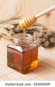 honeycomb and honey on wooden background