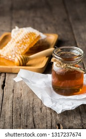 honeycomb with honey on wooden table background
