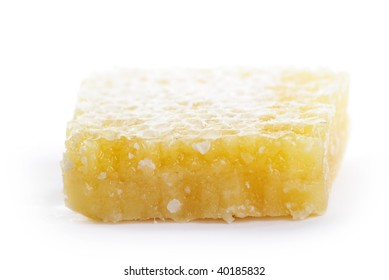 A honeycomb honey, in a white background