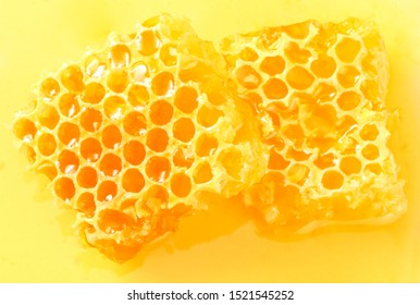 Honeycomb isolated on honey background. top view