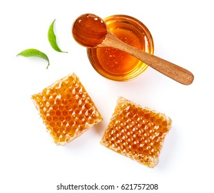 Honeycomb with jar and honey spoon and leaf isolated on white background, bee products by organic natural ingredients concept