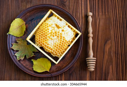 Honeycomb on a clay plate in a rustic style