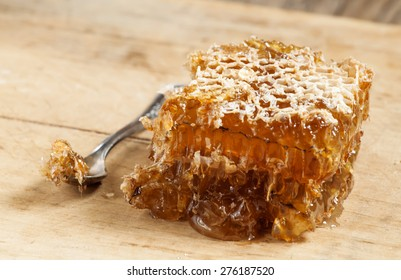 Honeycomb on old wooden table, selective focus