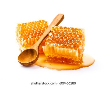 Honeycomb with spoon isolated on white background