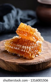 Honeycombs on wooden board. Raw honey, natural organic honey. Selective focus, rustic style