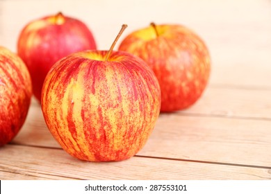 Honeycrisp apples with a wood background.