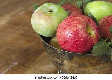 Honeycrisp and Granny Smith in a silver tarnished bowl