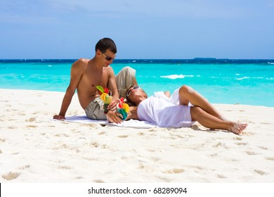 Honeymoon with cocktails on a tropical beach