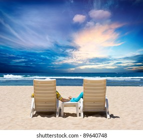 Honeymoon couple enjoy ocean sunset holding hands