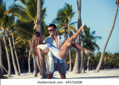 Honeymoon Couple on white sandy beach in Punta Cana, Dominican Republic