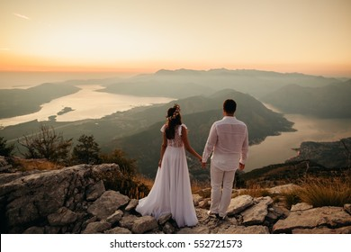 honeymoon couple travel mountains and sea view. Sunset in picturesque mountains. Kotor Bay, Montenegro.
