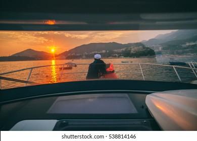 honeymoon couple travel on yacht. Back view. Montenegro