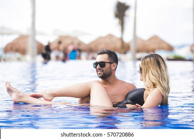 Honeymoon romantic lovers vacation on a tropical beach. Young happy lovers on romantic travel honeymoon having fun on vacation summer holidays romance.
