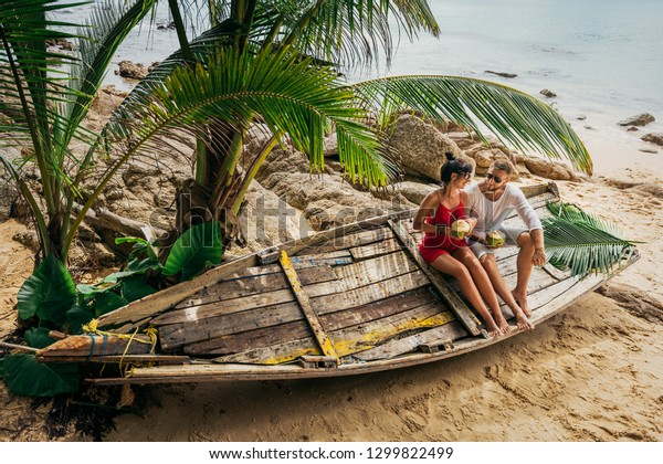 Honeymoon trip. Wedding travel. Couple in love on an island off the coast. Couple on the island. Man and woman in the Maldives. Relax on the island. Holiday romance. Travel to Asia. Thailand, Phuket