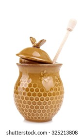 honeypot  and spoon for honey on a white isolated background