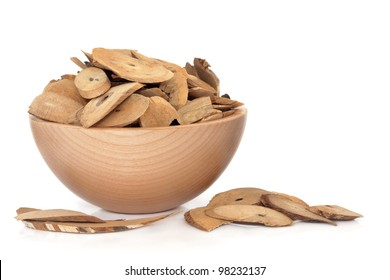 Honeysuckle stem herb used in chinese herbal medicine in a beech wood bowl on white background.  Ren dong teng, Rambus lonicerae japonicae.