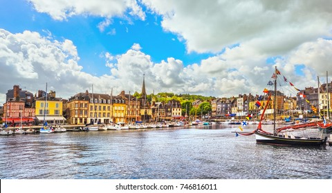 Honfleur famous village harbor skyline, boats and water. Normandy, France, Europe.