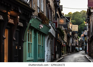 Honfleur, France - 2019.On the streets of an medieval city Honfleur. Favorite place for walks of local residents and tourists.