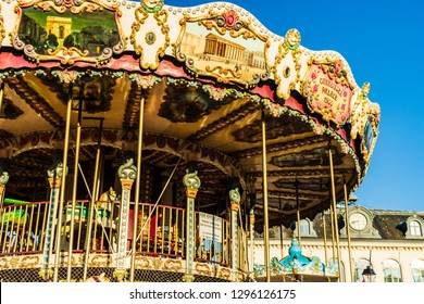 Honfleur, France - 2019.Circus carousel near the harbour of Honfleur, famous french town in Normandy.