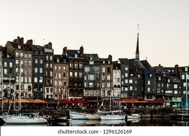 Honfleur, France - 2019.Spectacular famous harbor in Normandy, Honfleur skyline and water with boats.