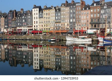 Honfleur, France, April 9th 2019: Reflections in Vieux Bassin in Honfleur, France