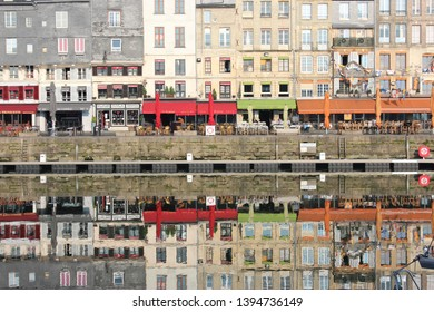 Honfleur, France, April 9th 2019: Shops in Vieux Bassin in Honfleur, France