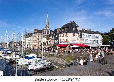 HONFLEUR, FRANCE - AUGUST 13: The old port of Honfleur, famous for having been painted many times by artists, on August 13, 2016 in Honfleur, France