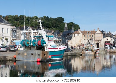 HONFLEUR, FRANCE - AUGUST 24, 2017: Harbor of historic city Honfleur with fishing ships
