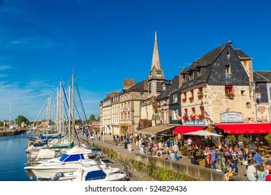 HONFLEUR, FRANCE - JUNE 18, 2016: Honfleur Harbour in a beautiful summer day, France on June 18, 2016
